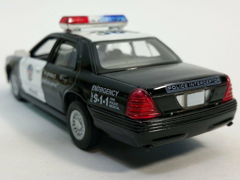 Металлическая машинка Kinsmart 1:42 «Ford Crown Victoria Police Interceptor» KT5327D инерционная / Черная
